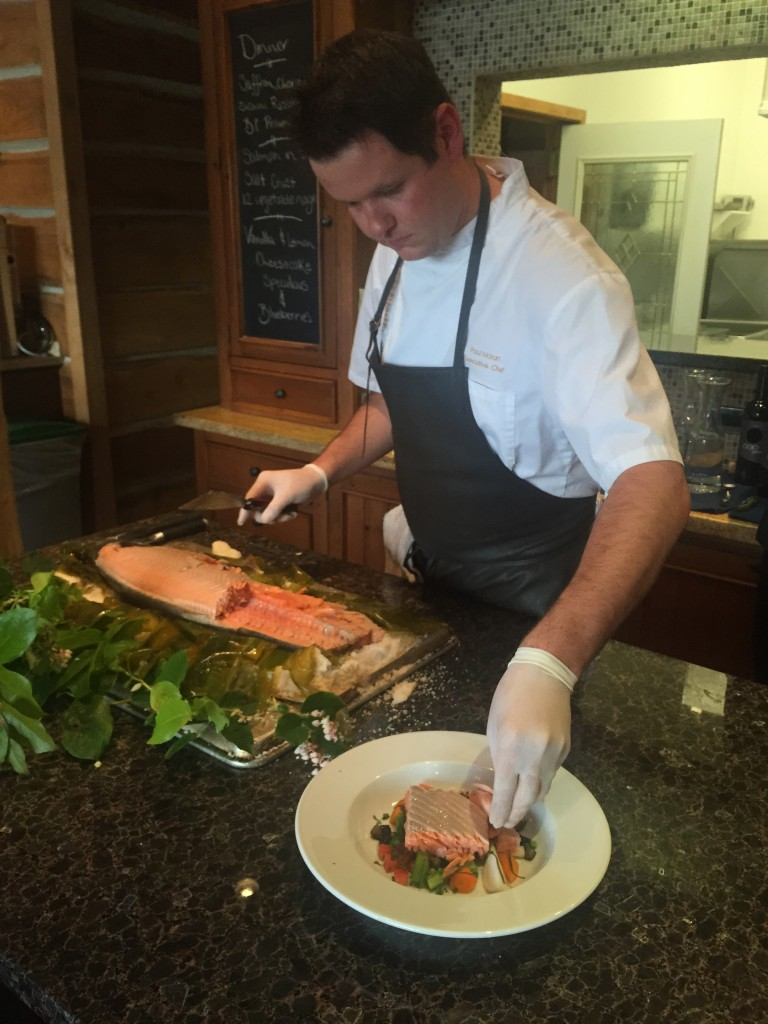 * Chef Paul Moran serving up Paul & Steph's famous salt baked Chinook Salmon at The Outpost.