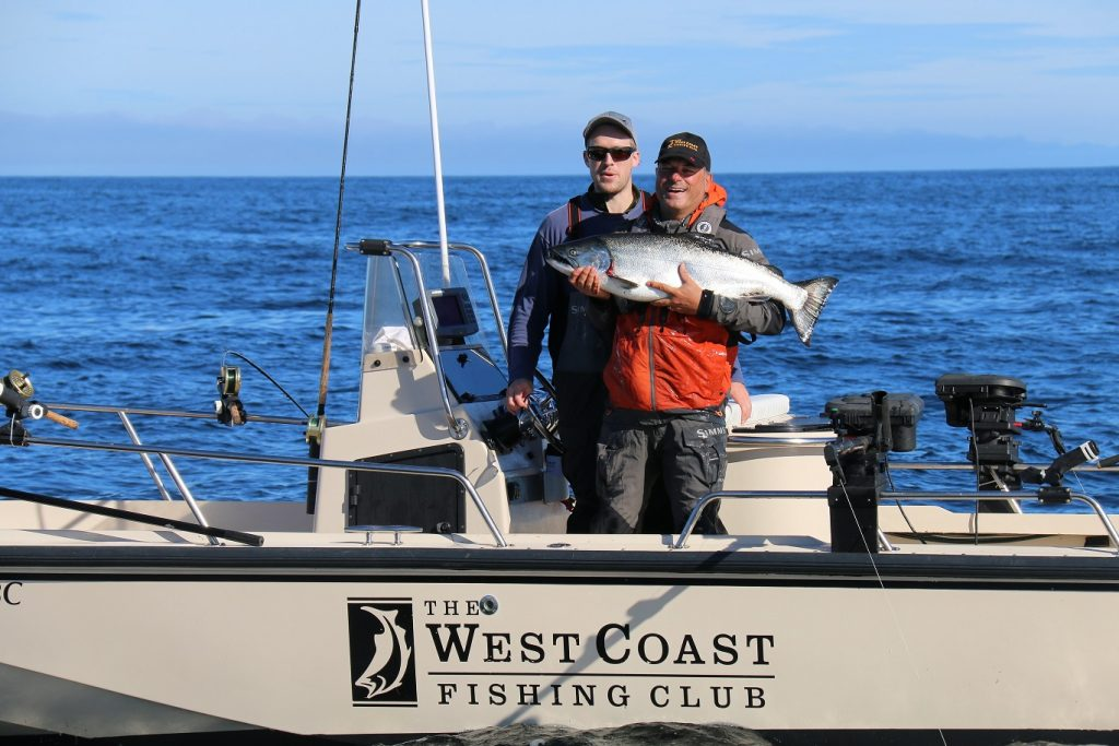 <em>* Don Wells and Chris Dale with a nice 24lb Chinook. </em>